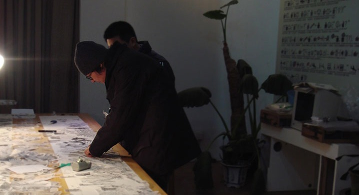 Xu Bing working on the print in his Beijing studio, Winter 2009.